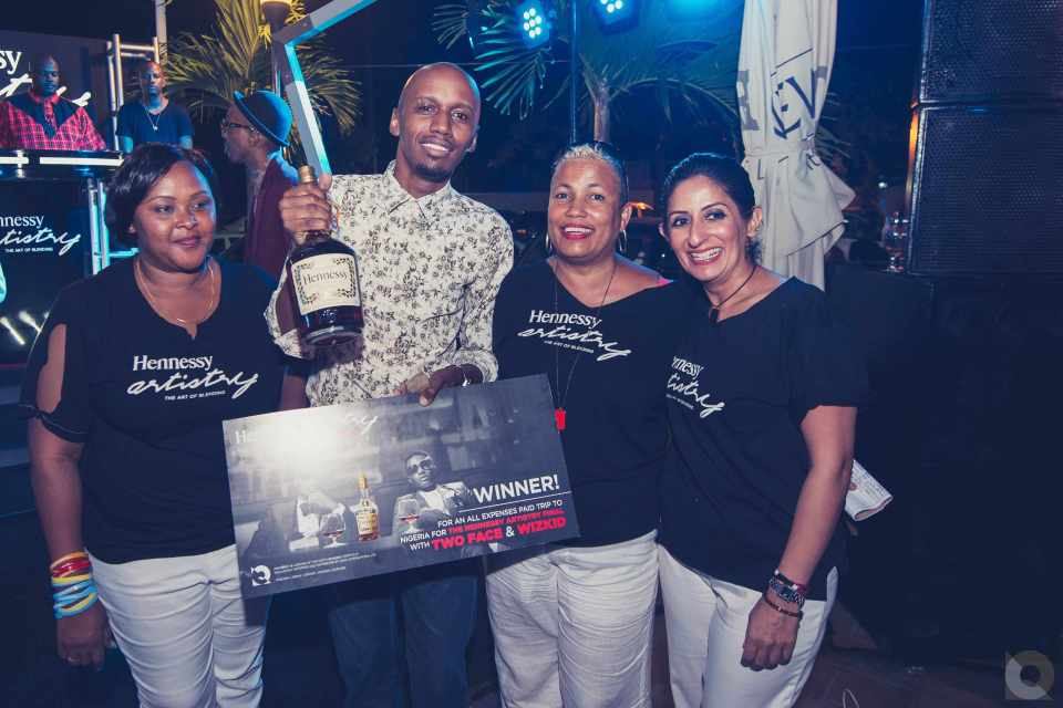 Cciza Williams, Winner of the all expense trip to Nigeria for the Hennessy Artistry Finale acceps his prize from Director of QWAY International Niloofer Hirjee and her team